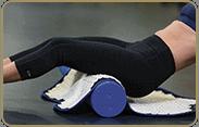 acupressure mat position: glutes, roller