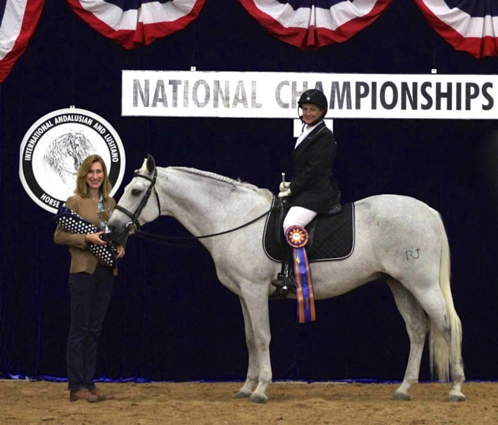 Kim Johan-Nass (right) and Vendito RJ accept the Accuhorsemat Cup Award from Colleen Elliot (left), co-founder of Acuswede, at the 2016 International Andalusian and Lusitano Horse Association (IALHA) National Championship Show